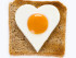 heart shaped cooked egg 'sunny side up' on a slice of square shape toast